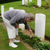 Mrs Betty Dickson visting the grave of Cpl W Dickson